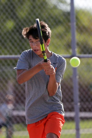 Harrison's Landon Mohr returns the ball during the No. 3 singles match of the IHSAA boys tennis sectional 56, Thursday, Oct. 3, 2019 in West Lafayette.