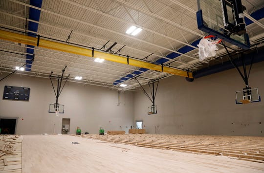 The wooden floor has begun to be installed at the new Thomas Ewing Junior High School Thursday, Oct. 3, 2019, in Lancaster.