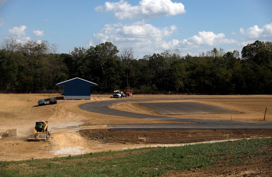 Construction continues on the six-lane track and football field at the new Thomas Ewing Junior High School Thursday, Oct. 3, 2019, in Lancaster. The school will also have dedicated softball and baseball fields.