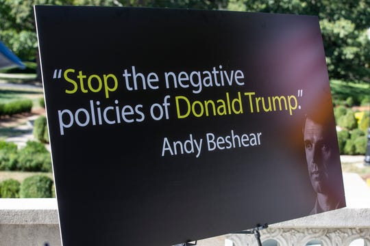 Gov. Matt Bevin displays a sign that quotes his rival, Andy Beshear, during a press conference on Friday.