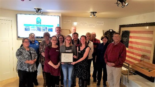 Members, volunteers and staff of the Manitowoc County Historical Society received the Governor's Award for Archival Innovation on Oct. 2. The award was presented to the museum by Matt Blessing, state archivist/director of Library, Archives and Museum Collections with the Wisconsin Historical Society.
