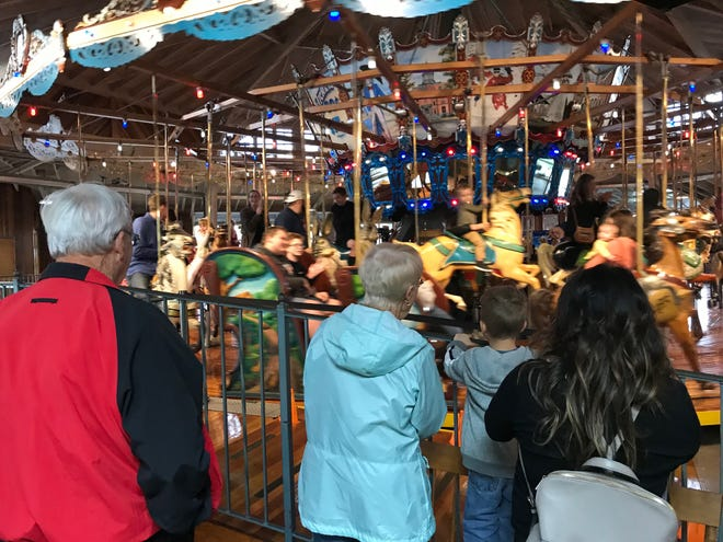 The Richland Carrousel Park was a busy place Friday night during Downtown Mansfield's First Friday Shop Hop for October.  And kids and adults were also in for a treat as the carousel only spins backward once a year and Friday night was it.