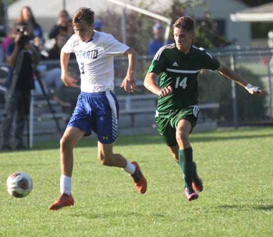 Ontario's Bostn Baxter is pressured by Madison's Dylan Metz during a 3-3 tie on Thursday.