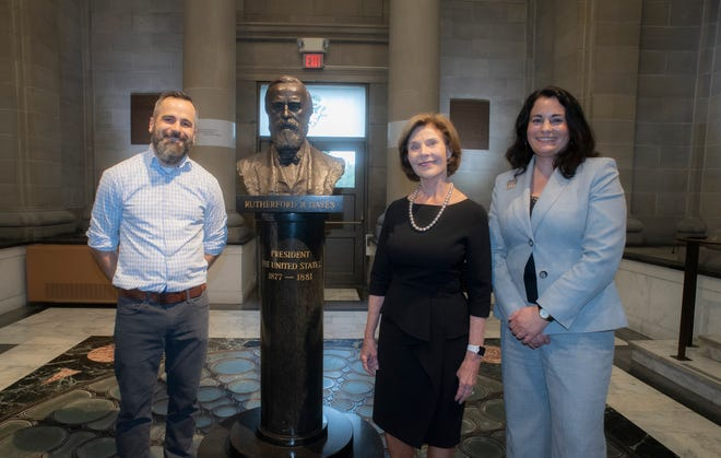 Former First Lady Laura Bush, center, visits the Hayes Presidential Library and Museums with Christie Weininger, executive director, and Dustin McLochlin, curator.