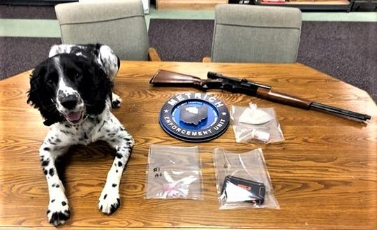 Marion Police Department K-9 detective Stash is shown with items seized during a drug raid on Thursday. Members of the MARMET/METRICH Drug Task Force, Marion Police Department, and Marion County Sheriff's Office seized 116 grams of methamphetamine and a rifle, and arrested John Ottaviano, 48, Marion.