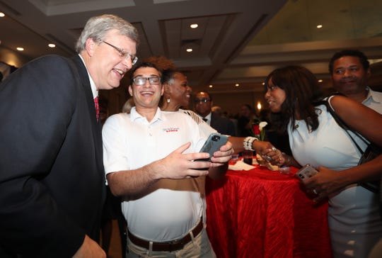 Memphis Mayor Jim Strickland celebrates his reelection with Daniel Saharovich at the Strickland party held Thursday at the Memphis Botanic Gardens in East Memphis.