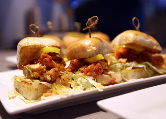 Let It Fly Sports Bar in Germantown menu features a spicy buffalo chicken slider.