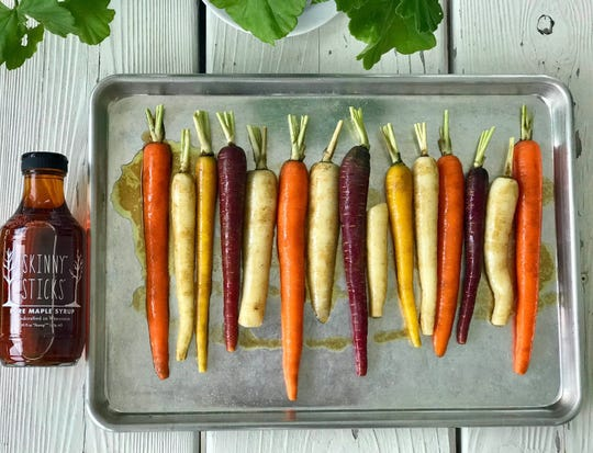 These colorful Maple-Kissed Roasted Rainbow Carrots are ready to be roasted in the oven using an incredibly simple maple syrup coating.