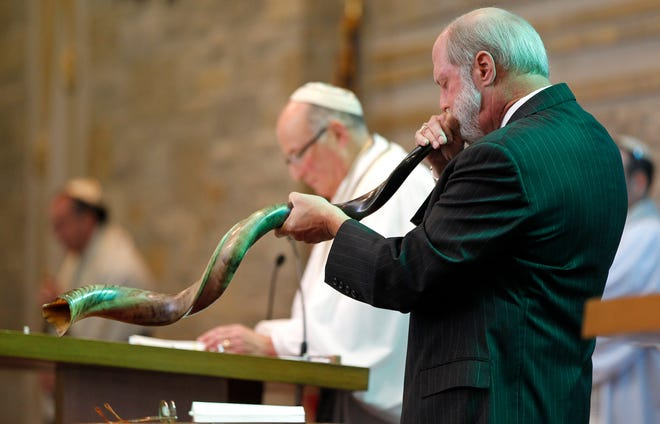 "Bob Pentler blows the shofar ushering  in the Jewish ""Days of Awe"" during Rosh Hashanah service in 2013 at Congregation Shalom in Fox Point."