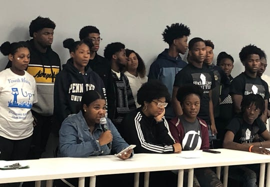 """Zion Rogers, a sophomore at Rufus King International High School, speaks Wednesday night at a news conference about violence in Milwaukee. Rogers announced she and the other teens would form a coalition of youth """"violence interrupters"""" to de-escalate and mediate conflicts."""