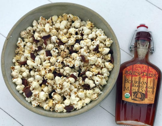 Treat yourself with a specialty syrup such as Bourbon Barrel Aged Maple Syrup from B&E's Trees to further boost the flavor of Maple Bacon Popcorn; attempt to eat it slow and relish every bite.
