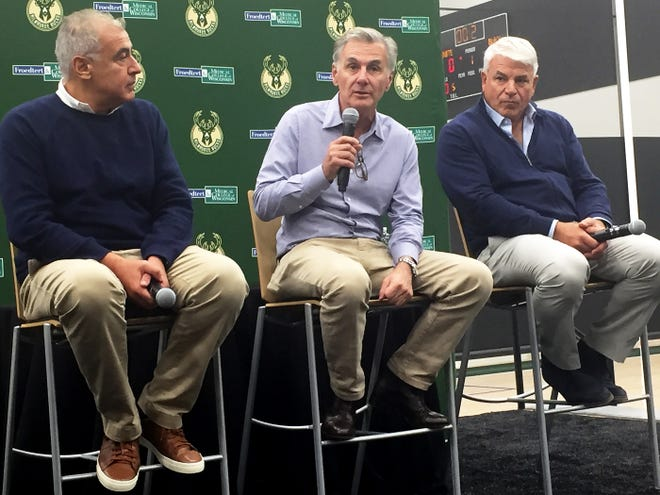 Three principal owners, from left, Marc Lasry, Jamie Dinan and Mike Fascitelli, address the state of the Milwaukee Bucks during a news conference Friday at the team's training facility. Wes Edens, the other man in their group, could not attend.