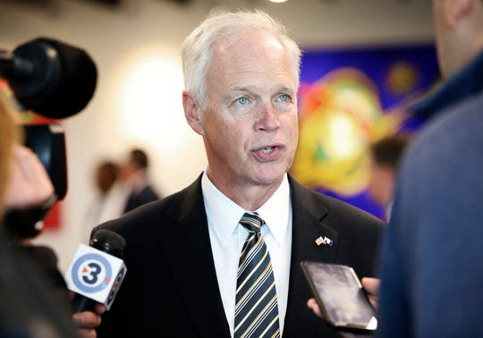 U.S. Sen. Ron Johnson, R-Wis., speaks with members of the media before meeting with the Middleton Chamber of Commerce at Serendipity Labs in Madison, Wis., Thursday, Oct. 3, 2019. Johnson Thursday that there was nothing wrong with President Donald Trump asking China and the Ukraine to investigate former Democratic Vice President Joe Biden and his son.