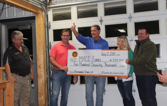 Lisa and Peter Schraufnagel, right, join Jon McGlocklin, center, of the MACC Fund and Steven Schraufnagel and Pat Gerbensky on Oct. 2 at Waukesha Gun Club for the presentation of the 2019 contribution from Christopher's Shoot, a sporting clays event and fundraiser held at the club.