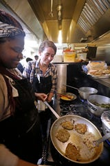 Caitlin Cullen, chef-owner of the Tandem, 1848 W. Fond du Lac Ave., is shown cooking with Tiffany Madlock in 2017. Cullen recently shattered her ankle and is unable to cook for two months.