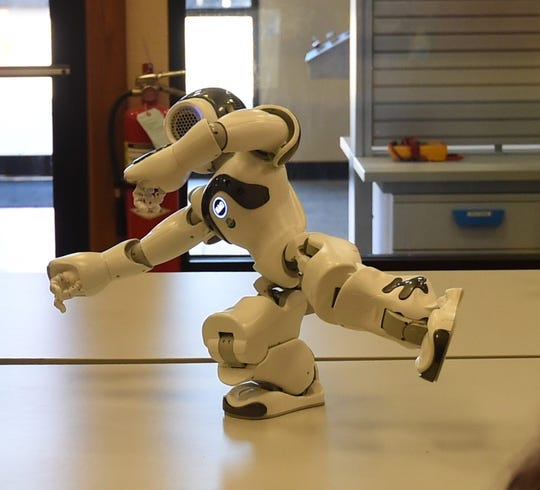NAO, a programmable miniature robot, performs Tai chi Thursday afternoon at Arkansas State University-Mountain Home's Manufacturers' Appreciation Day.