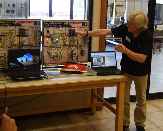 Meachatronics instructor Paul Swanson talks about the programmable logic controls on display Thursday at Arkansas State University-Mountain Home's Technical Center.