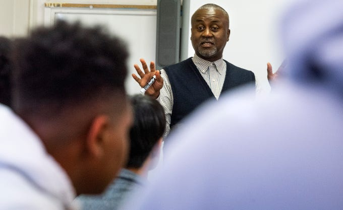 Local entrepreneur Boyd Stephens works with computer students at Booker T. Washington Magnet High School in Montgomery, Ala., on Friday October 4, 2019.