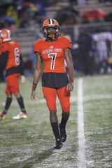 ASU defensive back Naytron Culpepper looks to the sideline in a game he was playing for his high school, Carol City.