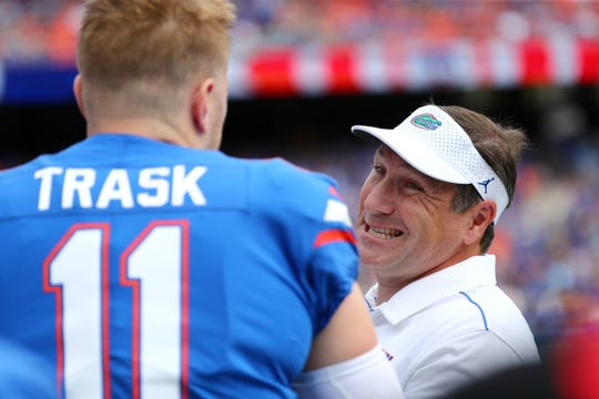 Florida Gators head coach Dan Mullen talks with quarterback Kyle Trask (11) during a game against Tennessee at Ben Hill Griffin Stadium on Sept. 21, 2019.