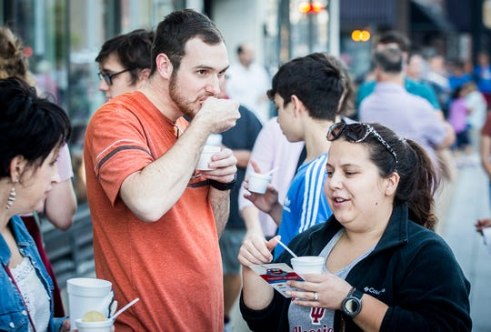 ArtsWalk attendees taste soup during the Soup Crawl fundraiser in downtown Muncie on Oct. 3, 2019.
