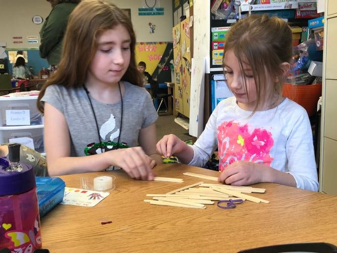 Students in Sarah Hill's Cowan Elementary School kindergarten class combined literacy and STEAM (science, technology, engineering, arts, and math) to create physical solutions to problems presented in classic storybooks as part of a Robert P. Bell Education Grant-funded project last school year.