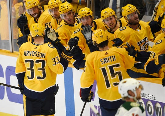 Nashville Predators right wing Viktor Arvidsson (33) celebrates his goal with teammates making the score 4-2 during the third period at Bridgestone Arena in Nashville, Tenn., Thursday, Oct. 3, 2019.