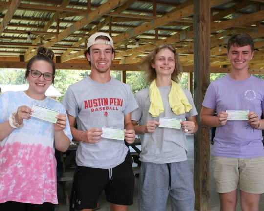 Students show off their rewards during the ACT Counts outing at Honeysuckle Hill Farm.