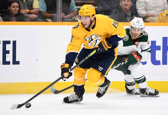 Nashville Predators center Calle Jarnkrok (19) moves the puck during the first period at Bridgestone Arena in Nashville, Tenn., Thursday, Oct. 3, 2019.