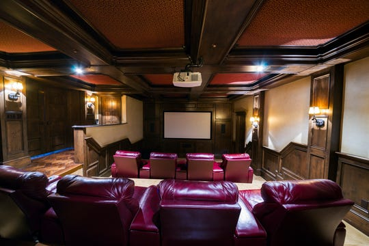 Home theaters can range from a few comfy chairs arranged theater style, to a full-on row of theater-style recliners, blackout curtains, popcorn machines and a theater and surround sound system that rivals many movie theaters.