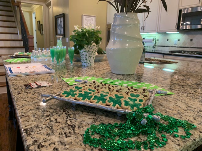 Realtor Robin Lyons likes to have a theme for her open houses. For St. Patrick's Day, everything was green, including the champagne.
