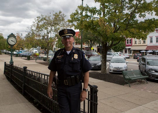 Bill Caskey, Granville's Chief of Police, poses for a picture outside the Granville Managers office downtown.