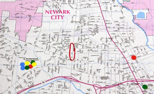 A city of Newark map is marked with stickers to indicate where attendees of a transit open house meeting to give residents a chance to give input about the gaps in current public transit.
