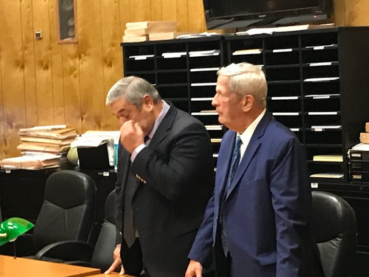 Dr. John Strobeck dabs a tear from his eye after a jury acquitted him of a fondling a female patient.