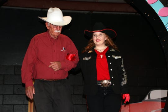 Calleigh Sweetser was escorted by her father John Sweetser during the Southwestern New Mexico State Fair Royalty Pageant on Thursday.
