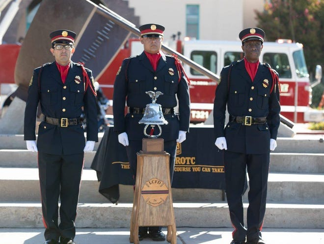 Las Cruces firefighters at a ceremony on the New Mexico State University campus.