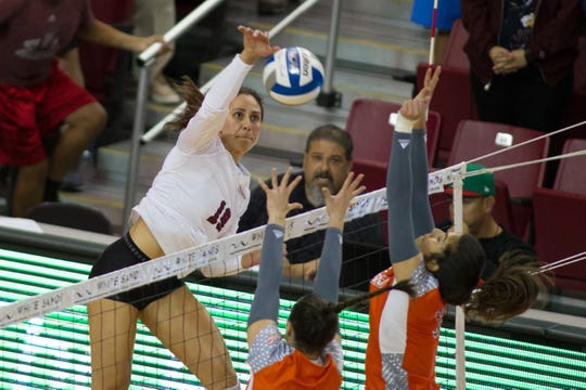 Redshirt sophomore Savannah Davison delivers a kill during New Mexico State's 3-0 sweep over UTRGV on Thursday, Oct. 3, at the Pan American Center.