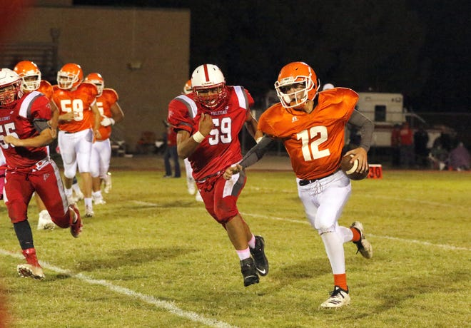 Loving's Edgar Dominguez (59) chases down Artesia JV quarterback Nathan Taylor (12) in their game on Oct. 3, 2019. Dominguez recorded a sack in the game.
