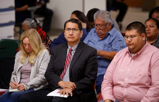 Navajo Nation President Jonathan Nez, center, listens to comments from former uranium mine workers during a forum on Oct. 2 at the Department of Diné Education in Window Rock, Arizona.