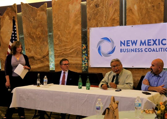At center, Four Corners Economic Development CEO Arvin Trujillo answers a question while Mark Robeck, left, and Rep. Rod Montoya, right, listen. Carla Sonntag moderated the discussion.