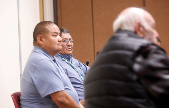 Former uranium miner Leslie Begay, center, listens to comments from a fellow mine worker during the Oct. 2 forum about uranium mining's legacy on the Navajo Nation at the Department of Diné Education in Window Rock, Arizona.