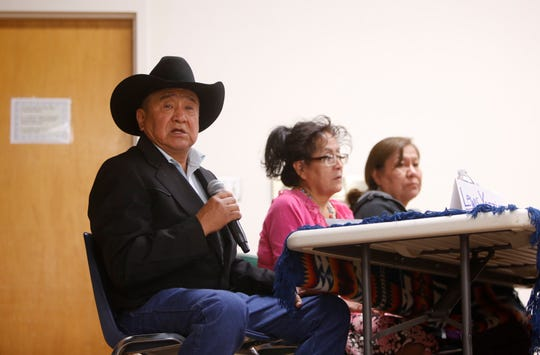 Lewis Yazzie, left, talks about effect of uranium mining to residents in Monument Valley, Utah during the Oct. 2 forum about uranium mining's legacy on the Navajo Nation at the Department of Diné Education in Window Rock, Arizona.