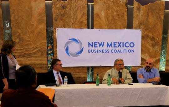Mark Robeck, left, Arvin Trujillo and Rod Montoya participate in a panel discussion Oct. 3 in Farmington.