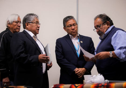 From left, former Navajo Nation President Peterson Zah, former underground uranium miner Phillip Harrison Sr., Navajo Nation Vice President Myron Lizer and U.S. Rep. Raúl Grijalva talk after the Oct. 2 forum about the legacy of uranium mining on the Navajo Nation at the Department of Diné Education in Window Rock, Arizona.