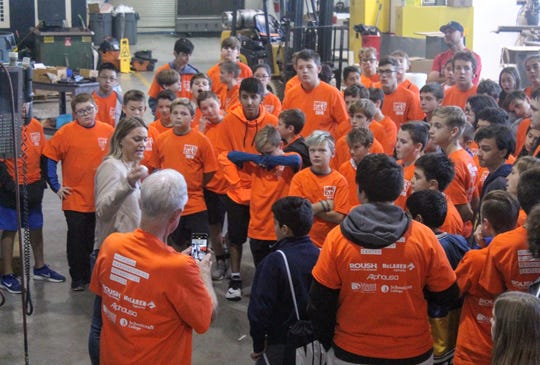 Holmes Middle School students listen during a presentation at Linear AMS in Livonia Friday for Manufacturing Day.