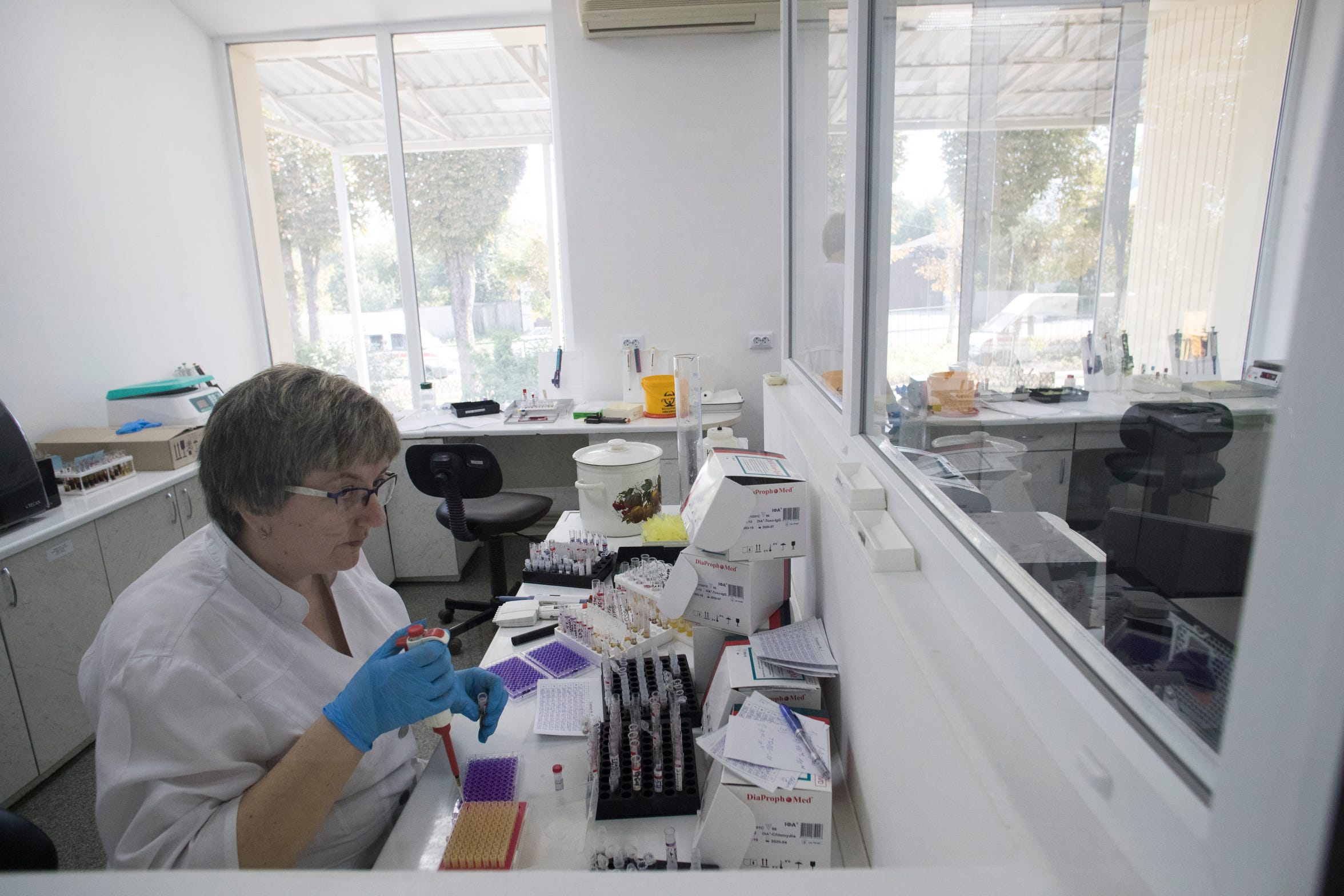 A laboratory technician works with blood samples at Kharkiv Oblast Prophylactic Center in August 2019 in Kharkiv, Ukraine.