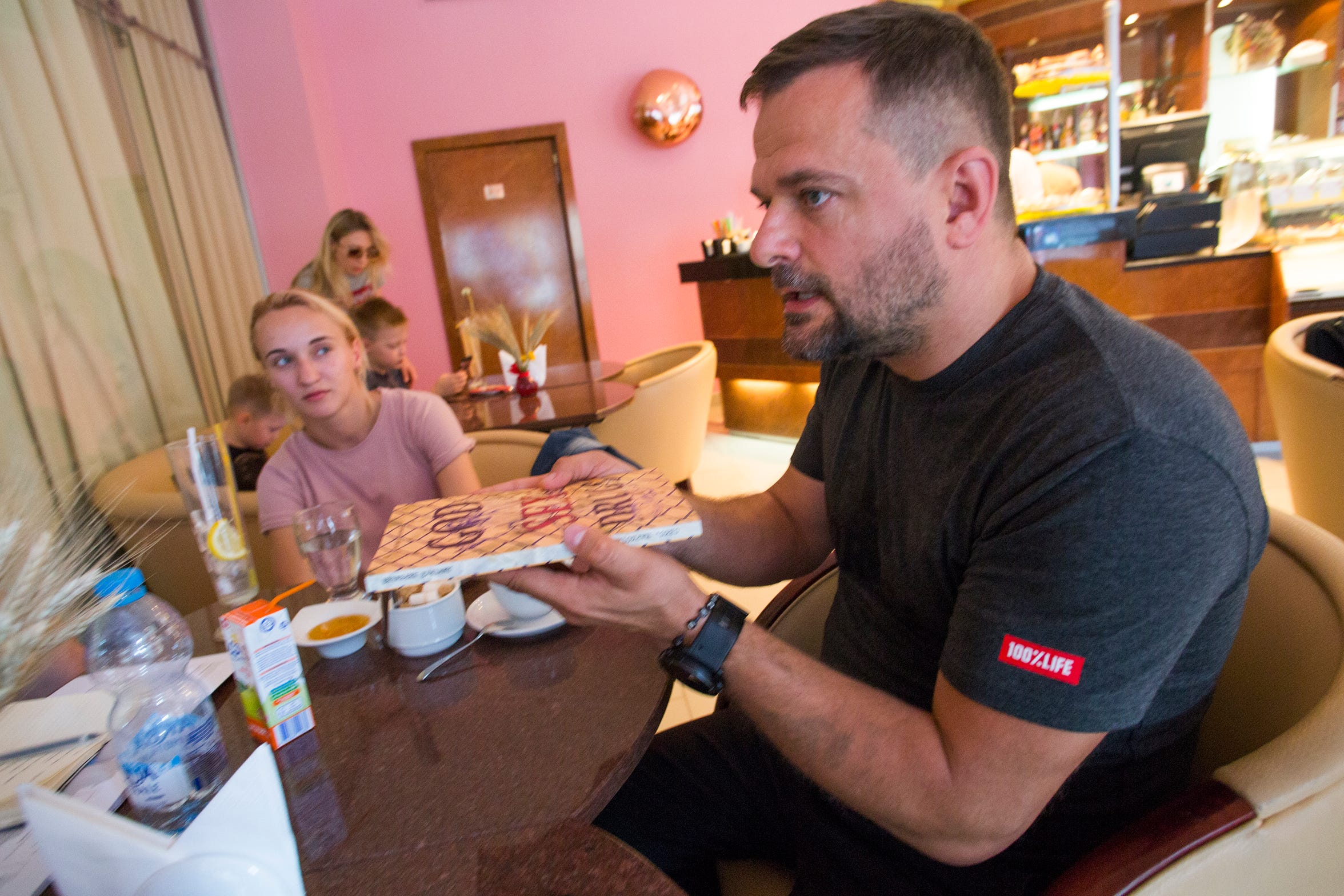 100% Life's Dmytro Sherembei, a Ukrainian activist for people living with HIV discusses his work and the situation in Ukraine at a cafe in Kyiv, Ukraine in August, 2019.