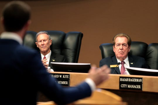 Rancho Mirage City Council members Ted Weill, left, and Richard Kite listen to Brandon Weimer, co-founder of Brandini Toffee speak in support of In-N-Out during the council meeting in Rancho Mirage, Calif., on Thursday, October 3, 2019. The seats held by Kite and Weill are up for election in April 2020, and both say they will run again.