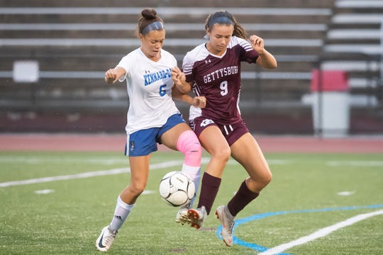 Gettysburg's Lora Bertram (9) and Kennard-Dale's Brianna Mack both kick the ball during a YAIAA Division II soccer match at Warrior Stadium on Thursday, October 3, 2019. The Warriors won, 9-0.