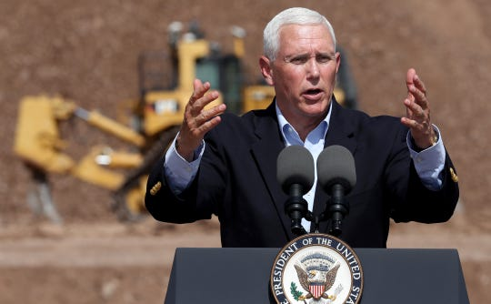 Vice President Mike Pence talks to the gathered employees of Caterpillar during a visit to the Tinaja Hills Demonstration and Learning Center, Green Valley, Ariz., Oct. 3, 2019.